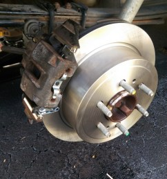 install the brake pads into the caliper and slide the caliper on with the noise damper bolt follow the appropriate torque specs for uh the bottom bolt  [ 679 x 1200 Pixel ]