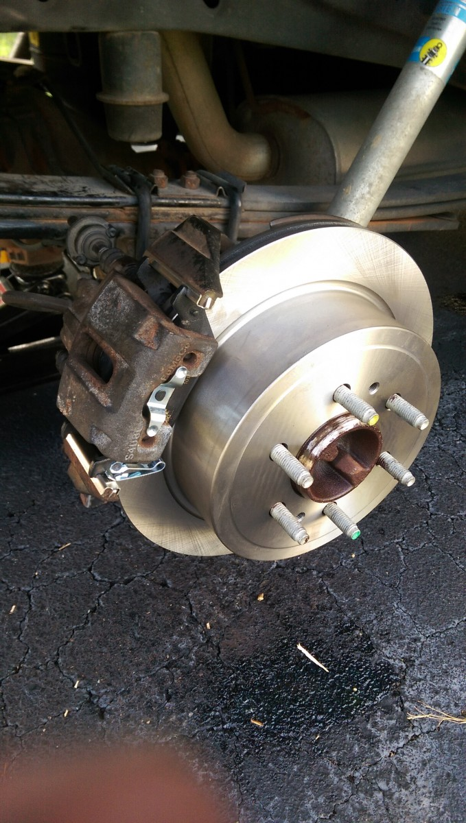 medium resolution of install the brake pads into the caliper and slide the caliper on with the noise damper bolt follow the appropriate torque specs for uh the bottom bolt