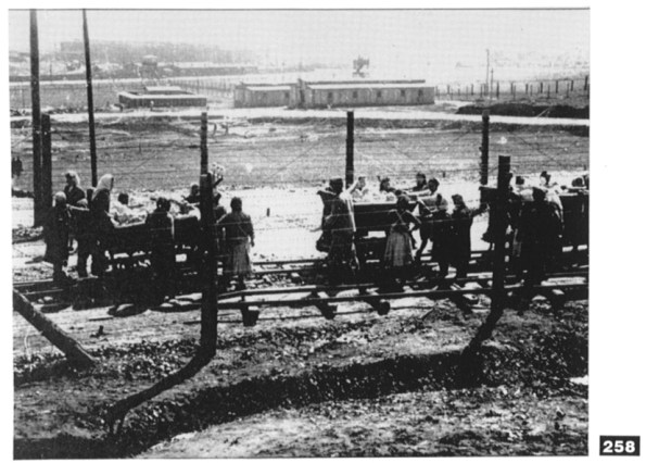 Women inmates on rest break in the Plaszow camp, before pushing the stone-laden carts up the hill