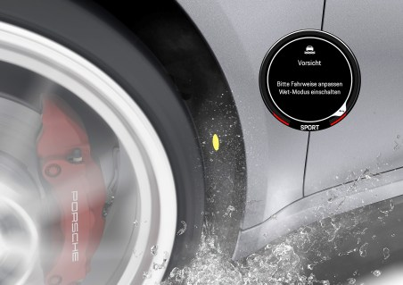 """Das einzigartige Assistenzssystem """"Porsche Wet Mode"""" warnt den Fahrer vor drohendem Aquaplaning, indem akustische Sensoren in den vorderen Radhäusern aufgewirbeltes Spritzwasser registrieren. Foto: Auto-Medienportal.Net/Porsche"""