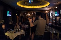 A couple is singing at Karaoke