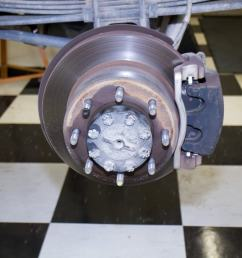 here you see the stock rear brake rotor and the 2 piston [ 1400 x 933 Pixel ]
