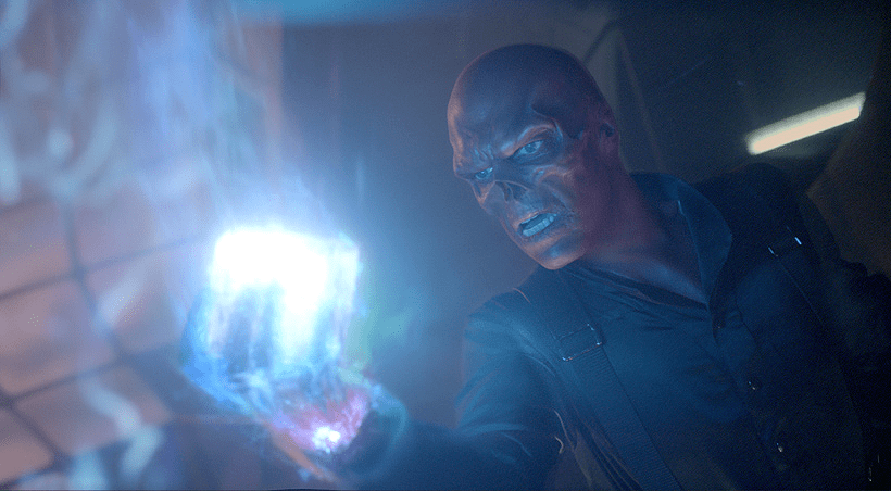red skull holds the tesseract