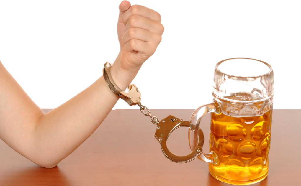 beer and hand cuffs