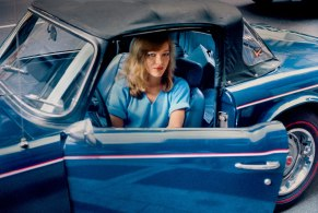 Robert Herman Blonde in a Blue Convertible, New York, NY, 1981.
