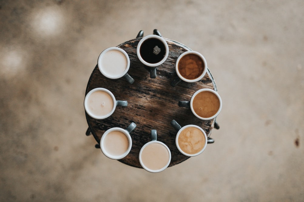 Set of cups with coffee of different shades