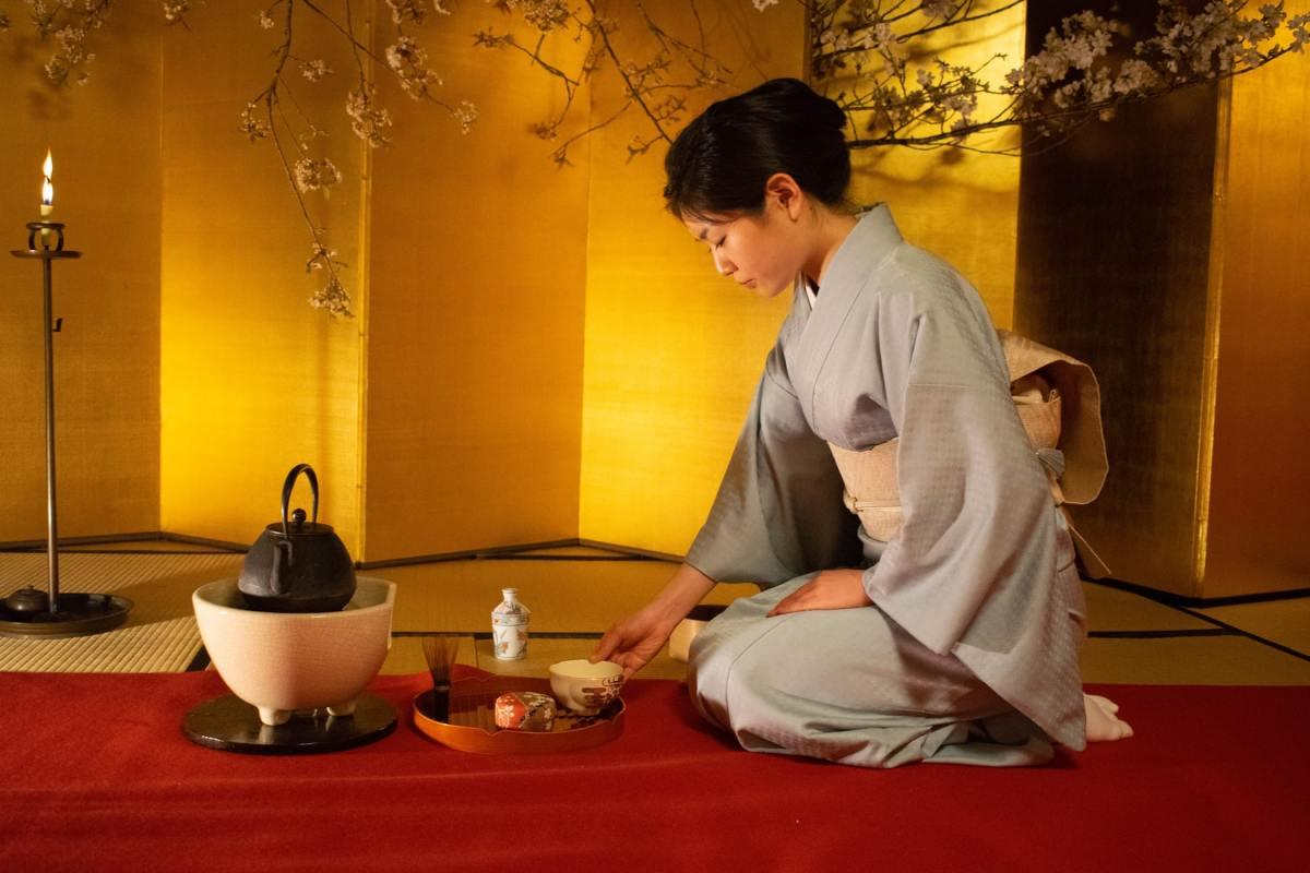 A Japanese woman serving tea