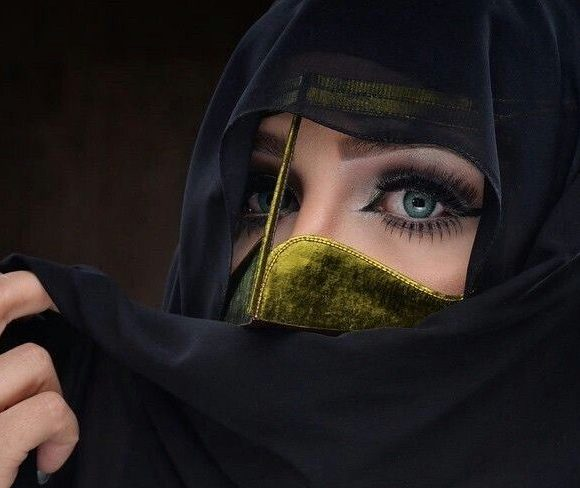 Arab woman covering her face