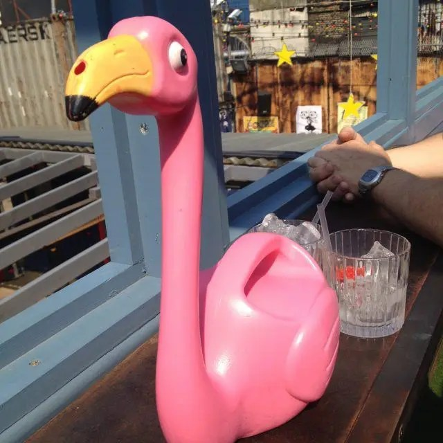 Cute things to do in East London - drink cocktails from a flamingo at Dinerama.