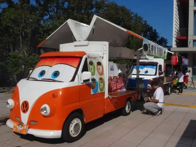 Ice cream truck with eyes parked at Songshan Cultural and Creative Centre near Taipei 101