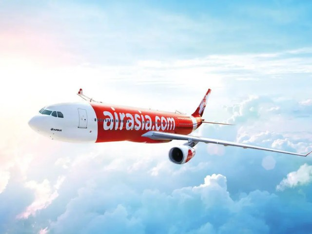 Air Asia X plane flying in the clouds
