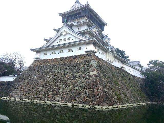 Back view of Kokura castle showing the moat and the stepped design
