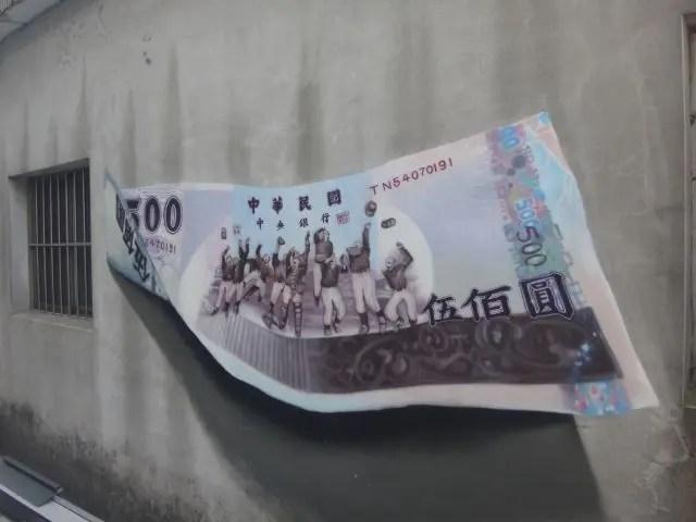 Street art painting of a dollar bill in Taiwan