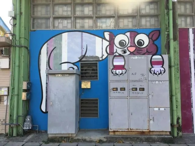 Utility boxes with a cut painted on them in Kaohsiung Taiwan