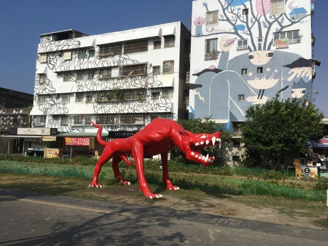 red dinosaur statue
