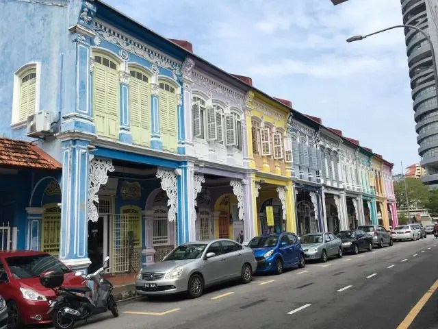 Row of shophouses in Penang painted in pastel colours