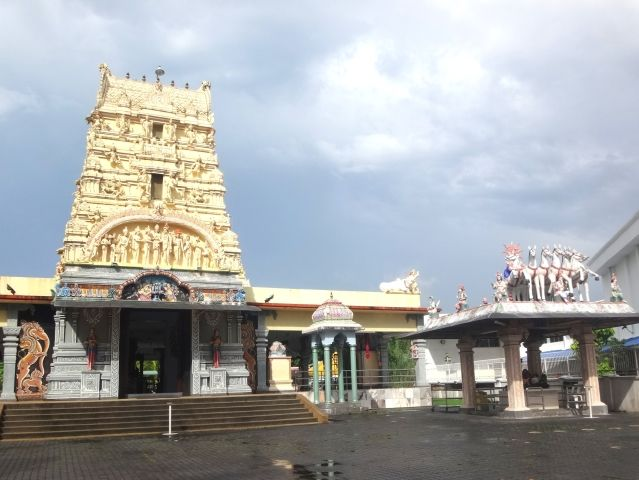 Hindu temple with a yellow tower