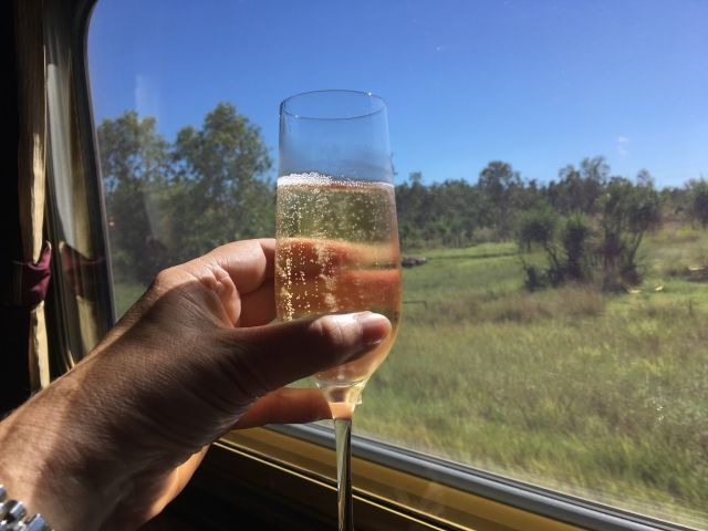 Champagne glass next to a window on The Ghan