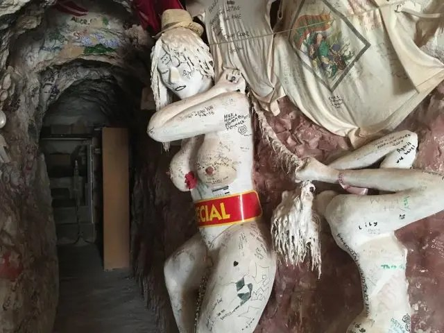 Carved statue of a woman Inside Crocodile Harry's home Coober Pedy