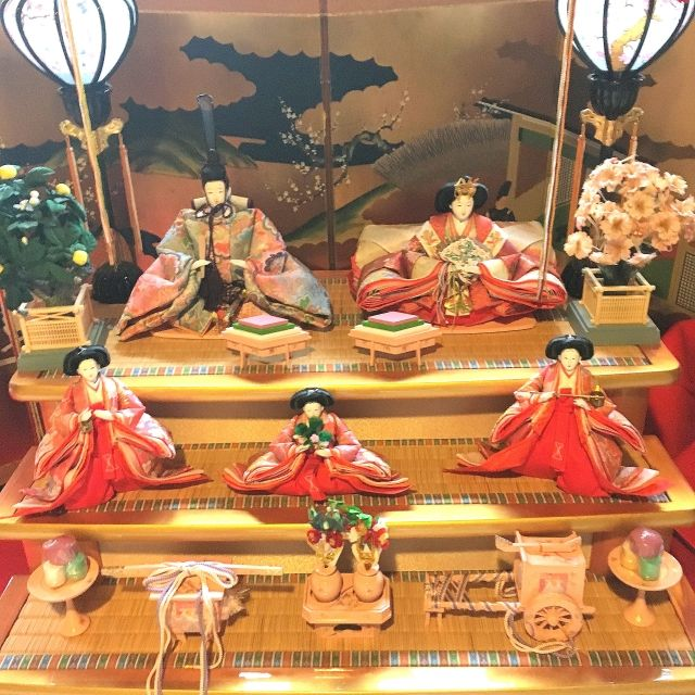 Hina dolls displayed on steps at the Japanese Doll Festival