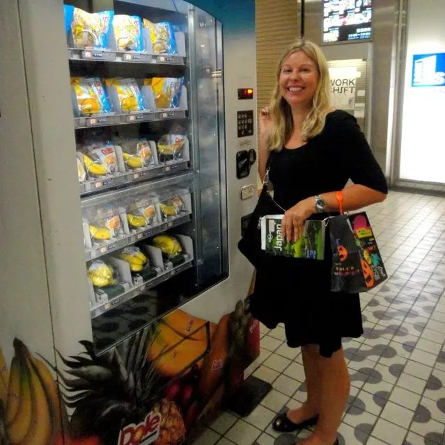 Woman ordering from the banana vending machine in Tokyo