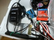 Arduinos, DC shield and power adapters.