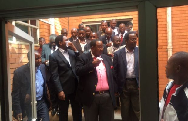 UPND leader Hakainde Hichilema, his vice Geoffrey Bwalya Mwamba, party officials and lawyers after being teargassed at the Lusaka High Court - picture by UPND media team