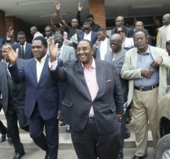 UPND Leader Hakainde Hichilema with his vice Geoffrey Mwamba at the Lusaka High Court -picture by Tenson Mkhala
