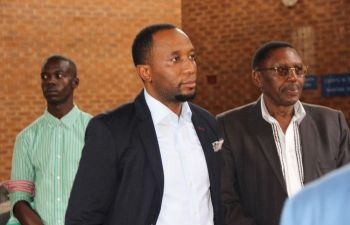 Mark Mubalama (left) with his father Mark snr at the Lusaka Magistrates' Court - picture by Tenson Mkhala
