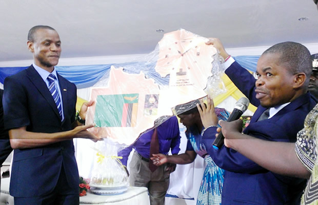 Janny Sikazwe receives his honour from Provincial Education Office organising Committe through Central Province Minister Sydney Mushanga. Picture by Muliyunda Lilembalemba