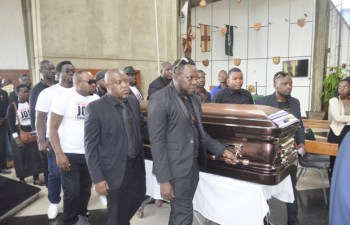 Various artist carrying Joe Chibangu's casket at Cathedral of the Holy Cross in Lusaka-Picture by Tenson Mkhala