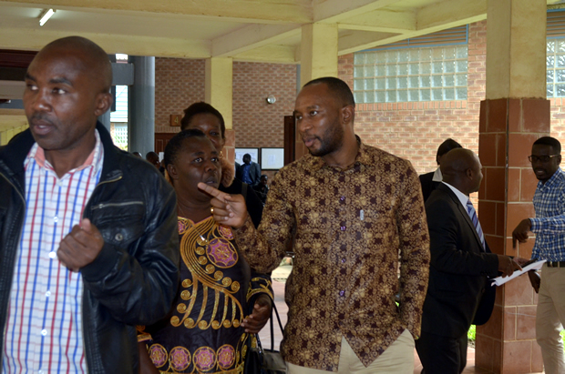 Mark Mubalama (r) with his relatives at Lusaka's Magistrates Court -February 27, 2017-Picture by Tenson Mkhala