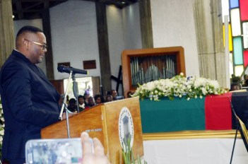 Zambia's High Commissioner to South Africa Emmanuel Mwamba speaks during funeral church service for Regina at Cathedral of the Holy Cross in Lusaka-picture by Tenson Mkhala