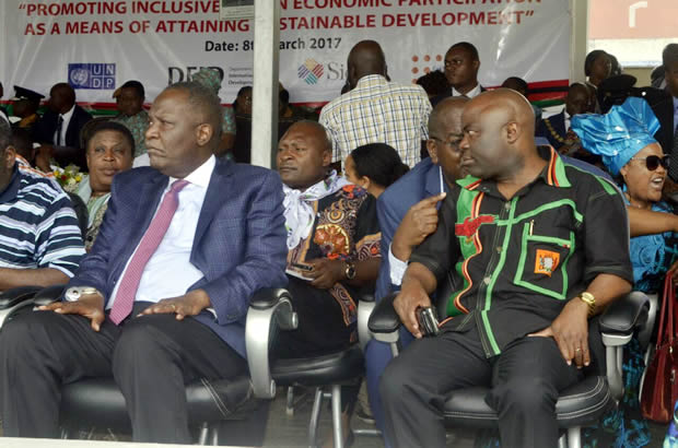 Finance minister Felix Mutati with Home Affairs minister Kapyongo at the Women Day in Lusaka-picture by Tenson Mkhala
