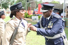 Inspector General of Police Kakoma Kanganja awards officers at the 2017 Police Day at the Lusaka showgrounds on March 4 - Picture by Joseph Mwenda