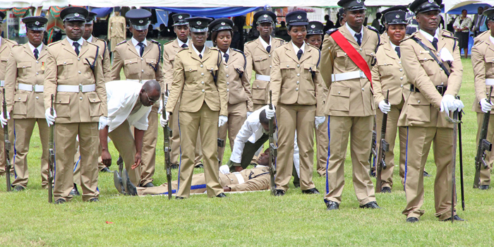 Police medical officers help a colleague who collapsed on parade duringf the 2017 Police Day at the Lusaka showgrounds on March 4 - Picture by Joseph Mwenda