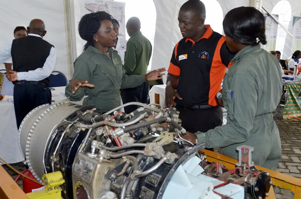 ZAF officer explains to member of the public on the airplane machine operates at East Park Mall in Lusaka-picture by Tenson Mkhala