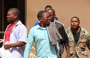 Chilufya Tayali being taken to Woodlands police cells from Lusaka's Magistrate Court-picture by Tenson Mkhala