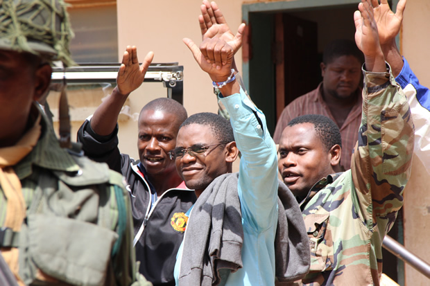 Chilufya Tayali being taken to Woodlands police cells from Lusaka's Magistrates Court-picture by Tenson Mkhala