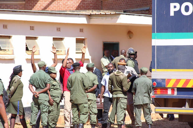 UPND leader Hakainde Hichilema waves at his supporters at Court before taken back to Lusaka Central Prison-Picture by Tenson Mkhala