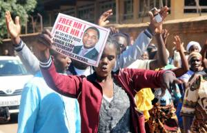 UPND supporter displays HH's placard at Court-Picture By Tenson Mkhala