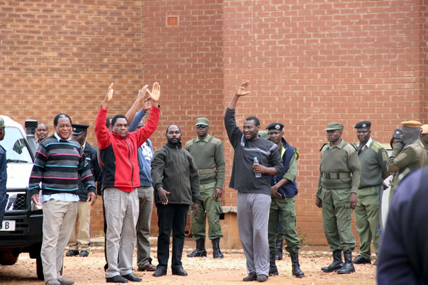 UPND laeder HH waves at his supporter at Court-Picture By Tenson Mkhala