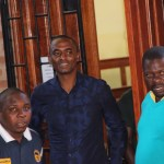 Chilanga MP Keith Mukata (c) with some of the plain clothed police officers who escorted him at Lusaka Magistrates' Court -Picture by Tenson Mkhala