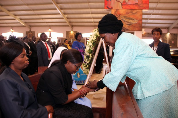Vice president Inonge Wina greets late Health permanent secretary John Moyo's wife Matilda during church service at the Cathedral of the Child Jesus Catholic Church in Lusaka picture by Tenson Mkhala