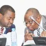 Parliamentary Public Accounts Committee (PAC) chairperson Haward  Kunda (l) speaks to acting Auditor General Ron Mwambwa when the Judicialy appeared  before the committee at Parliament building on November 15, 2017 - Picture by Tenson Mkhala