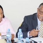 Financial Intelligence Centre (FIC)  acting board chairperson John Kasanga speaks to journalists as director general Mary Tshuma listens during a press briefing under the theme: 'We should not provid hiding place for criminals' held at Grand Palace Hotel in Lusaka on November 23, 2017 -m Picture by Tenson Mkhala