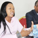 Financial Intelligence Centre (FIC) director general Mary Tshuma speaks to journalists as acting board chairperson John Kasanga listens during a press briefing in Lusaka on November 23, 2017 - Picture by Tenson Mkhala