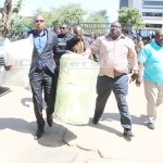 National Democratic Congress (NDC) leader Chishimba Kambwili arrives at Lusaka Central police station with a new mattress after being summoned by the police on January 23, 2018 - Picture by Tenson Mkhala