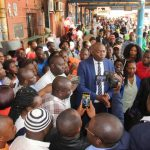 Lusaka Province minister Bowman Lusambo talks to journalists at City market when he visited the area on February 19, 2018 - Picture by Tenson Mkhala