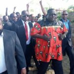 NDC leader Chishimba Kambwili arrives at Woodlands Police Station flanked by his spokesperson Eric Chanda (l) and other supporters on March 22, 2018